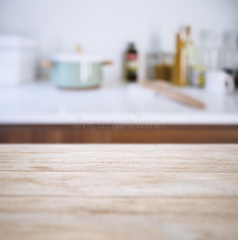 table top with blur kitchen pantry with kitchenware
