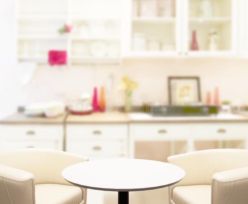 table top and blur kitchen room of background stock image