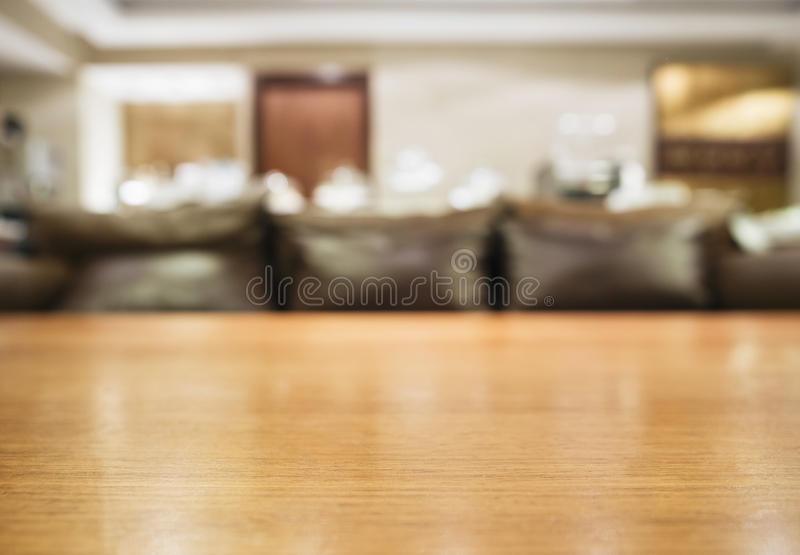 Table top with Blurred sofa Home interior decoration stock images