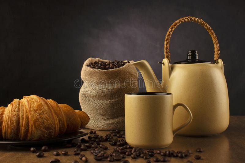Table top with coffee tea pot, cup and coffee beans, Pune, India stock image