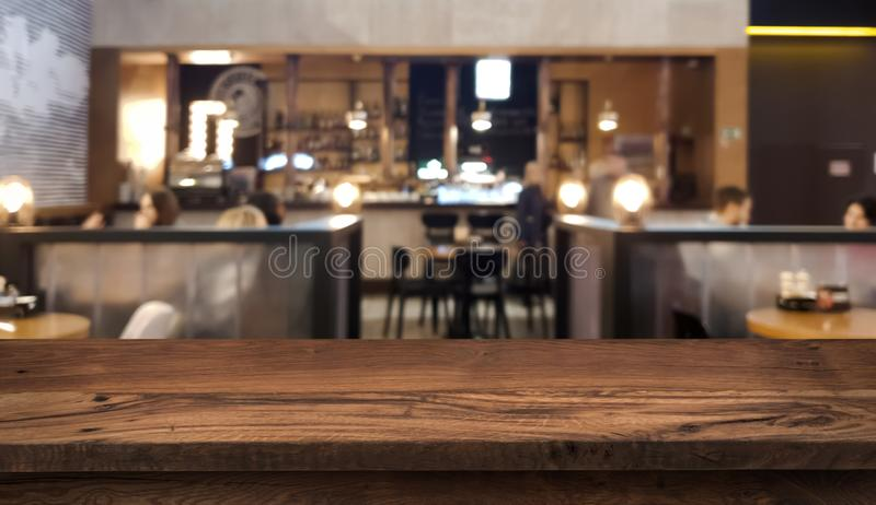 Table top counter with blurred people and restaurant interior background royalty free stock photos