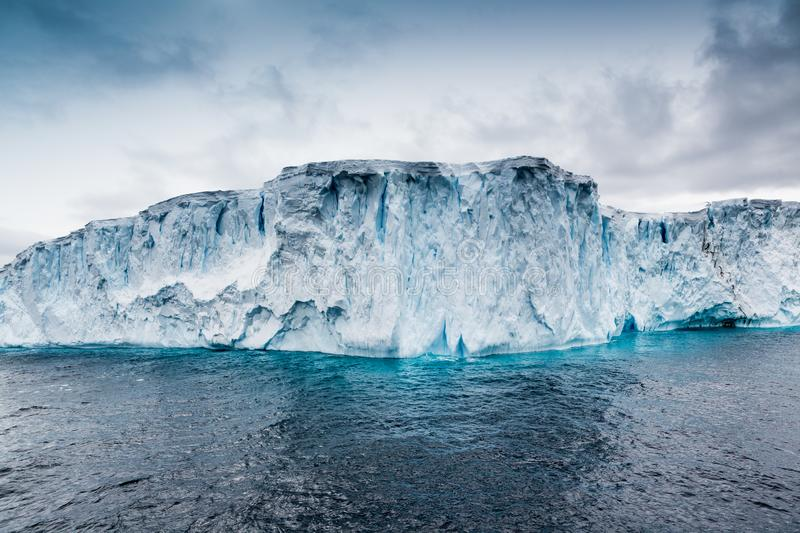 Table top icebergs float in Antarctic waters stock photography