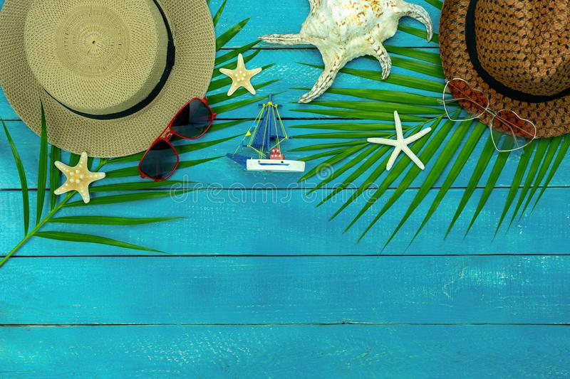 Table top view accessory of clothing women & men  plan to travel in summer holiday background concept. royalty free stock image