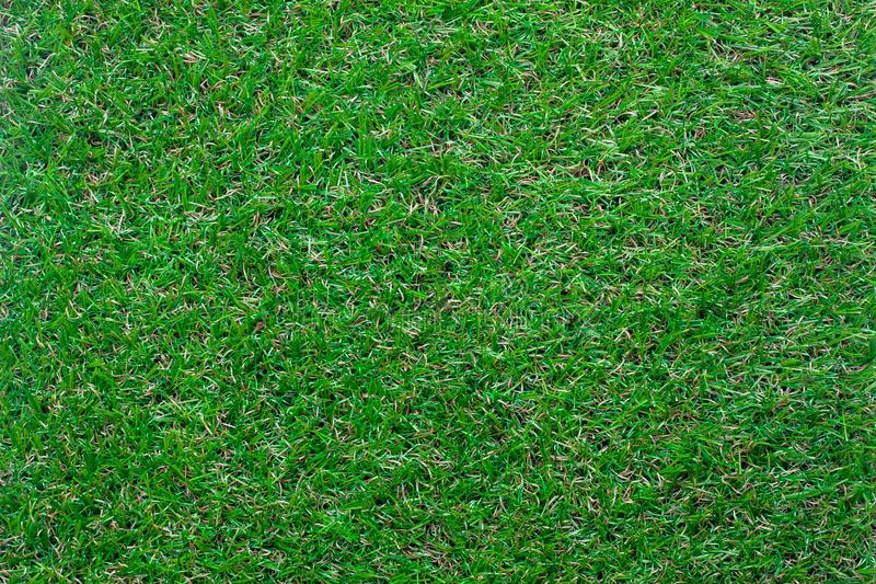 Table top view aerial image of the artificial green grass background. stock images