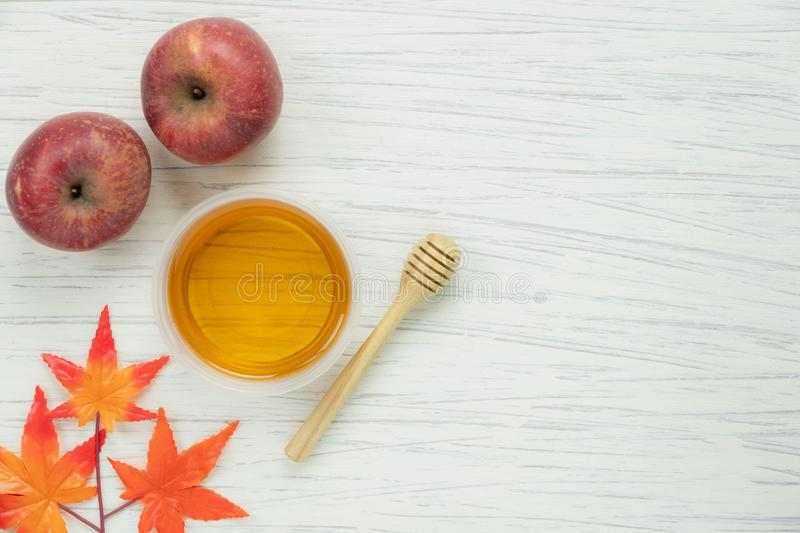 Table top view aerial image of decoration Fall harvest season or Rosh Hashanah day. Background concept.Flat lay red apple with honey bee and orange maple leaf stock photo