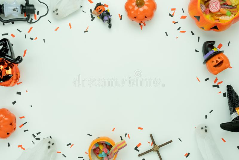 Table top view aerial image of decoration Happy Halloween day background concept. Flat lay accessories essential object to party the pumpkin & sweet candy on stock image