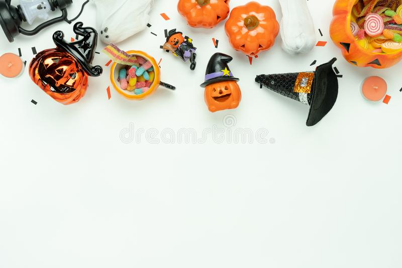 Table top view aerial image of decoration Happy Halloween day background concept. Flat lay accessories essential object to party the pumpkin & sweet candy on royalty free stock photography