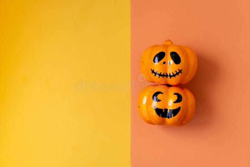 Table top view aerial image of decoration Happy Halloween day background concept.Flat lay accessories essential object to party. The pumpkin sweet candy on stock photography