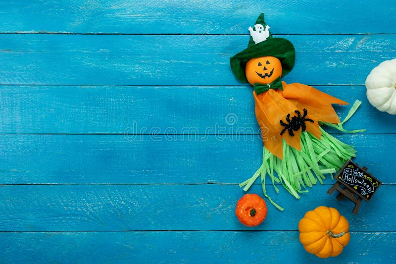 Table top view aerial image of decoration Happy Halloween day background concept. Flat lay accessories essential object to party the pumpkin doll & sweet candy royalty free stock image