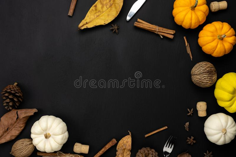 Table top view aerial image of decoration Happy Halloween or Thanksgiving day. Background concept.Flat lay accessory object to party the pumpkin & dry flower on royalty free stock photo