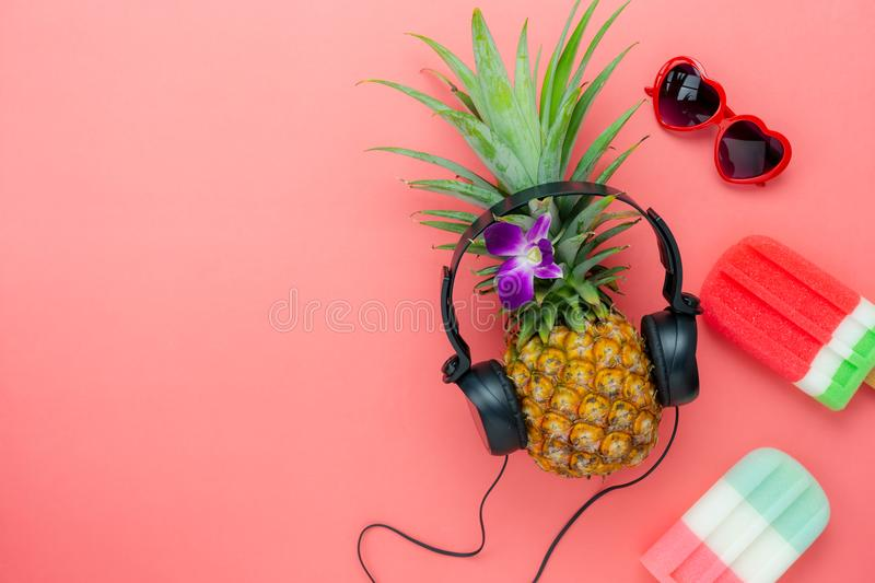 Table top view aerial image of food for summer holiday season & music background. Concept.Flat lay ice cream the pineapple listening radio by black headphone royalty free stock image