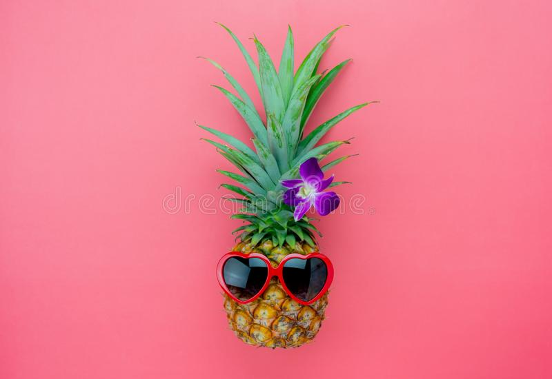 Table top view aerial image of summer & travel beach holiday in the season. Background concept.Flat lay sign objects on season.Pineapple wear red sunglasses on stock images
