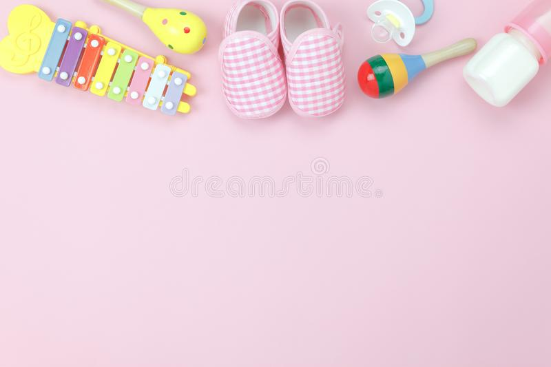 Table top view decoration kid toys for develop background concept. Flat lay baby shoes with items child on modern pink paper at office desk.Copy space for add royalty free stock images