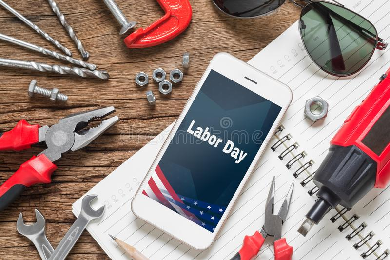 Table top view of decoration the sign of USA labor day background concept. Flat lay mock up Smart Phone With Labor Day USA Holiday royalty free stock images