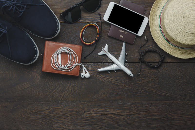 Table top view of essential item gentlemen for travel. With technology background concept.Mix variety object on modern rustic wood office desk.Several royalty free stock image