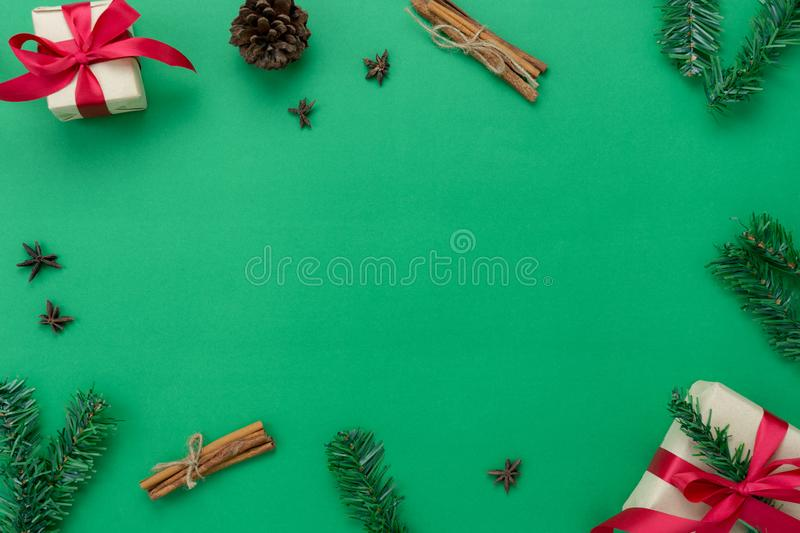 Table top view of Merry Christmas decorations & Happy new year ornaments concept.Flat lay essential objects the fir tree & gift. Box on modern rustic green royalty free stock photo