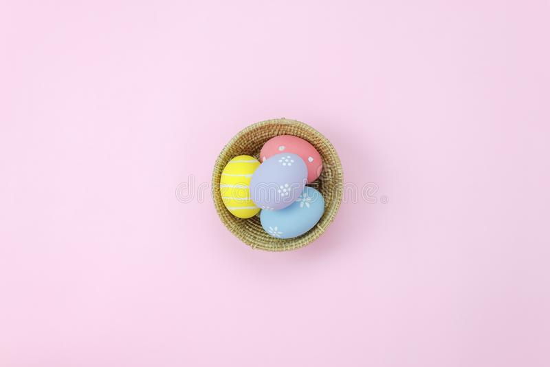 Table top view shot of arrangement decoration Happy Easter holiday. Background concept.Flat lay essential colorful bunny egg on modern rustic pink paper at home stock images