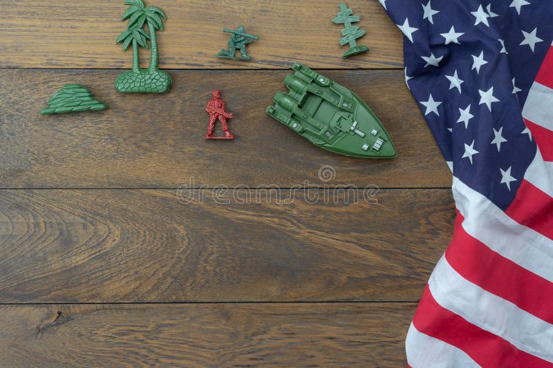 Table top view 4 th July independence day holiday background concept. Flat lay USA flag for sign of season with toy soldier on modern rustic brown wooden at stock photo
