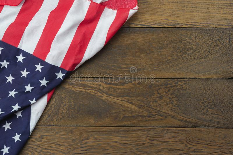 Table top view 4 th July independence day holiday background concept. Flat lay USA flag for sign of season on modern rustic brown wooden at office desk.Free stock photo