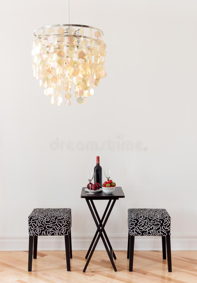 Table for two with bottle of red wine stock image