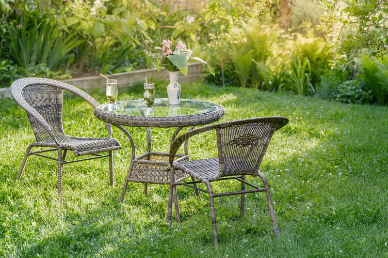 Table and two chairs in a garden stock photos