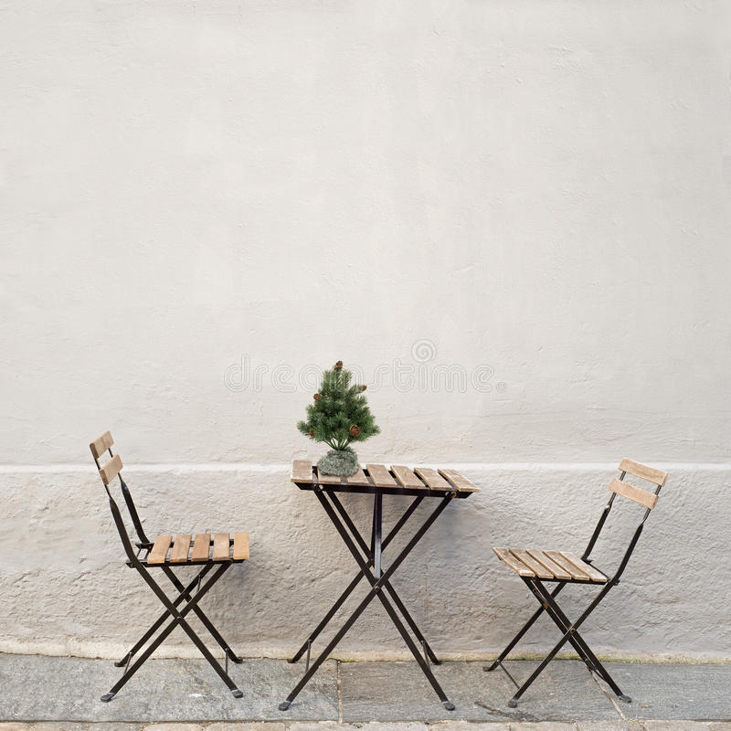 Table and two chairs near the wall stock photography
