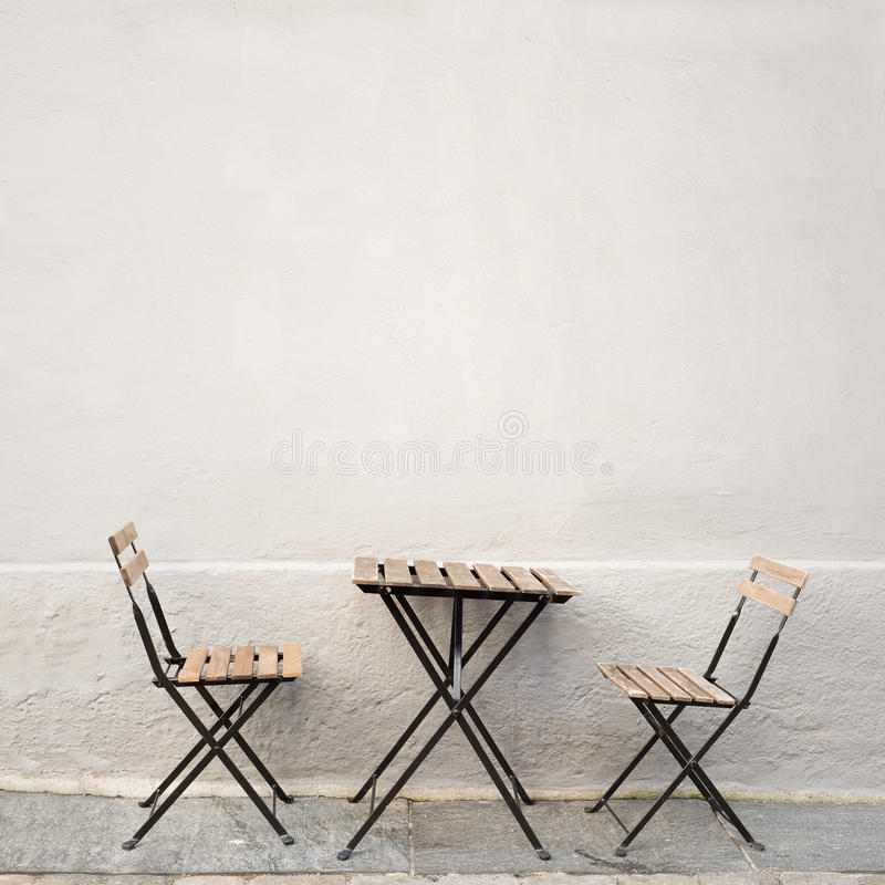 Table and two chairs near the wall royalty free stock photos