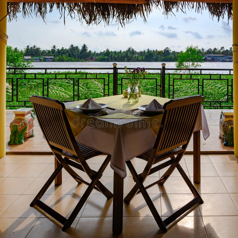 Beautiful view from table in Vietnamese restaurant to tributary river of Mekong River, near Ho Chi Minh City, Vietnam royalty free stock photo