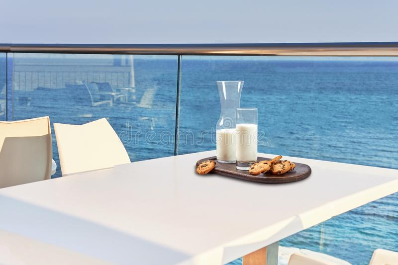 Table for two served with a breakfast on outdoor hotel balcony with a sea view. royalty free stock photo