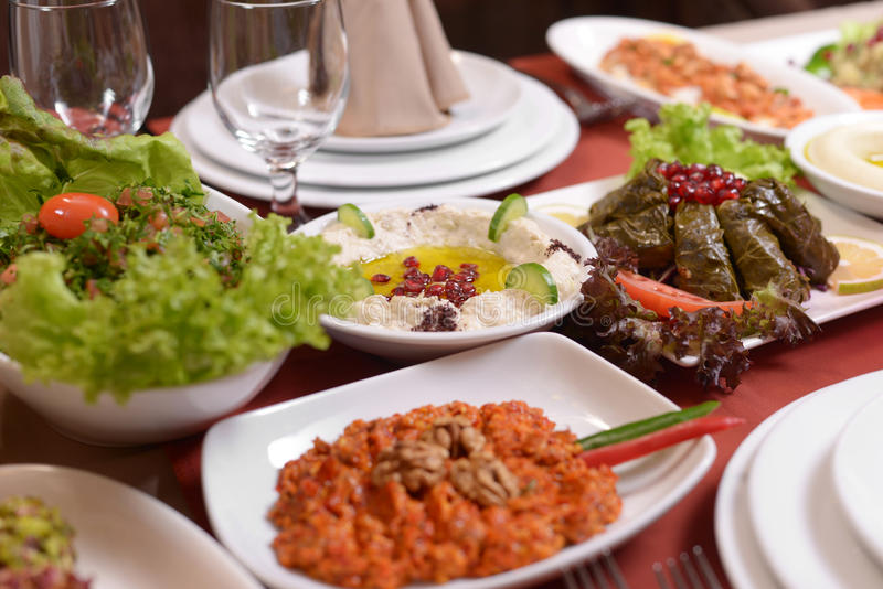 Table with various lebanese food served stock image
