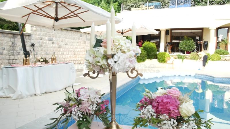 A Table At The Wedding Banquet Near The Pool Wedding Decoration