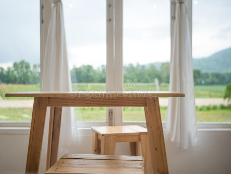 Table by the window in the house mountain background stock photo