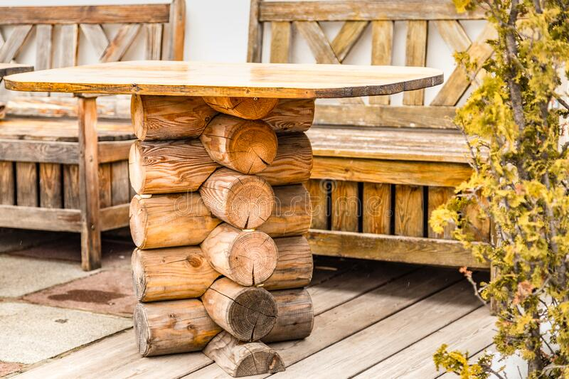 Table with wooden logs. In Italy stock photography