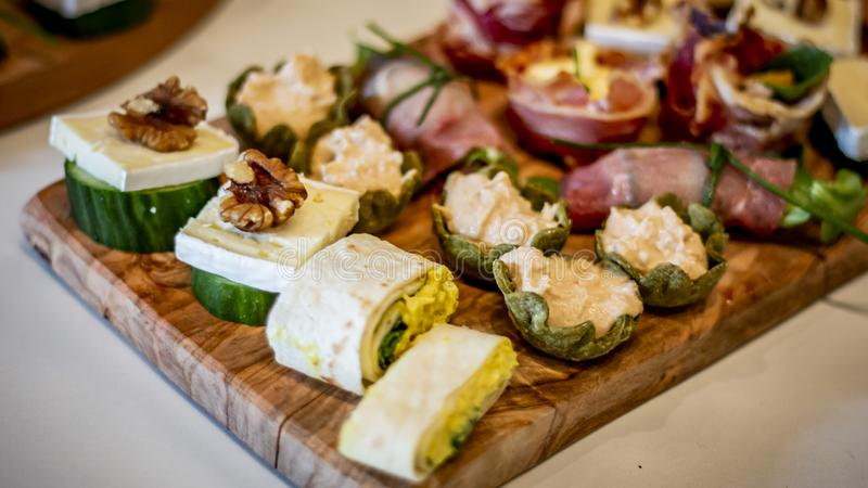 Table in the yard full of different finger food ready for the party. Catering concept.  stock photo