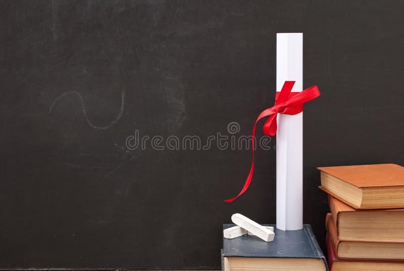Tableau avec un diplôme image libre de droits