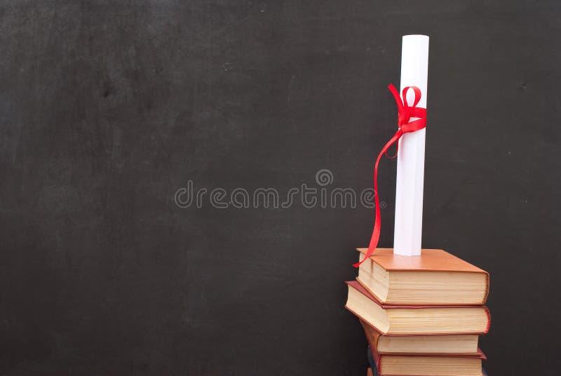 Tableau avec un diplôme image stock