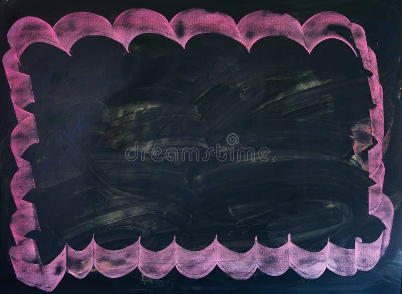Tableau noir avec le cadre rose tiré par la main pour attraper l'attraction de somebodies photographie stock