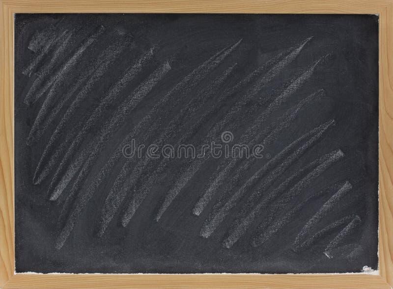 Tableau noir blanc avec des bavures de craie photos libres for Tableau noir craie