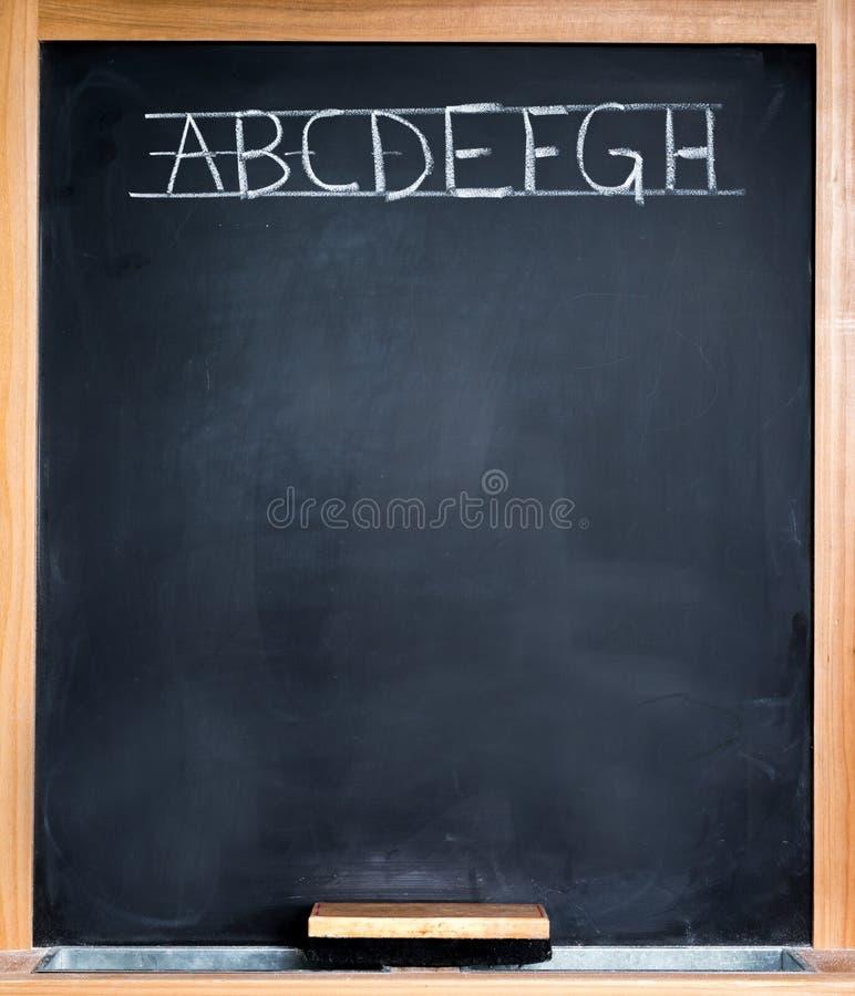 Tableau noir de salle de classe photographie stock libre de droits