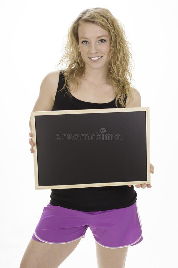 Tableau noir se retenant femelle convenable de jeunes photos stock