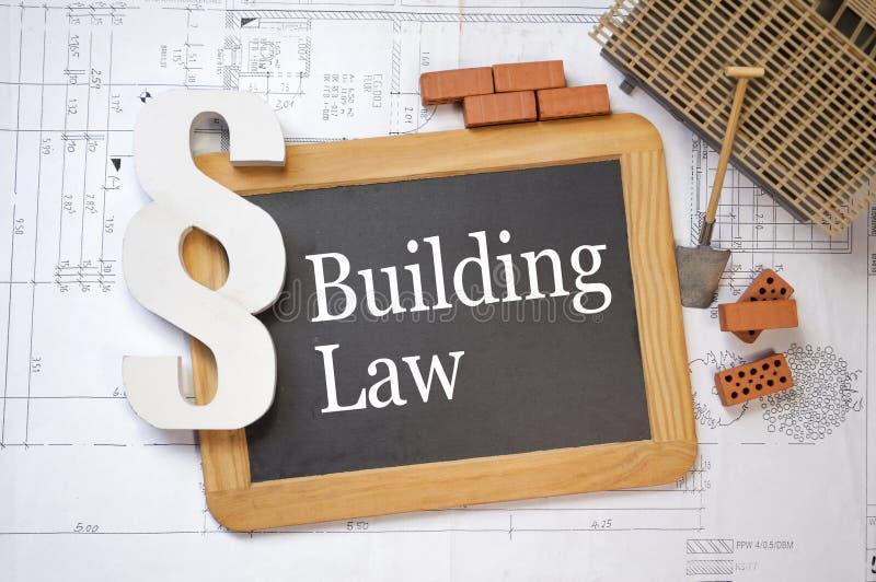 Tableau sur un plan de construction avec le paragraphe et la loi de bâtiment image libre de droits