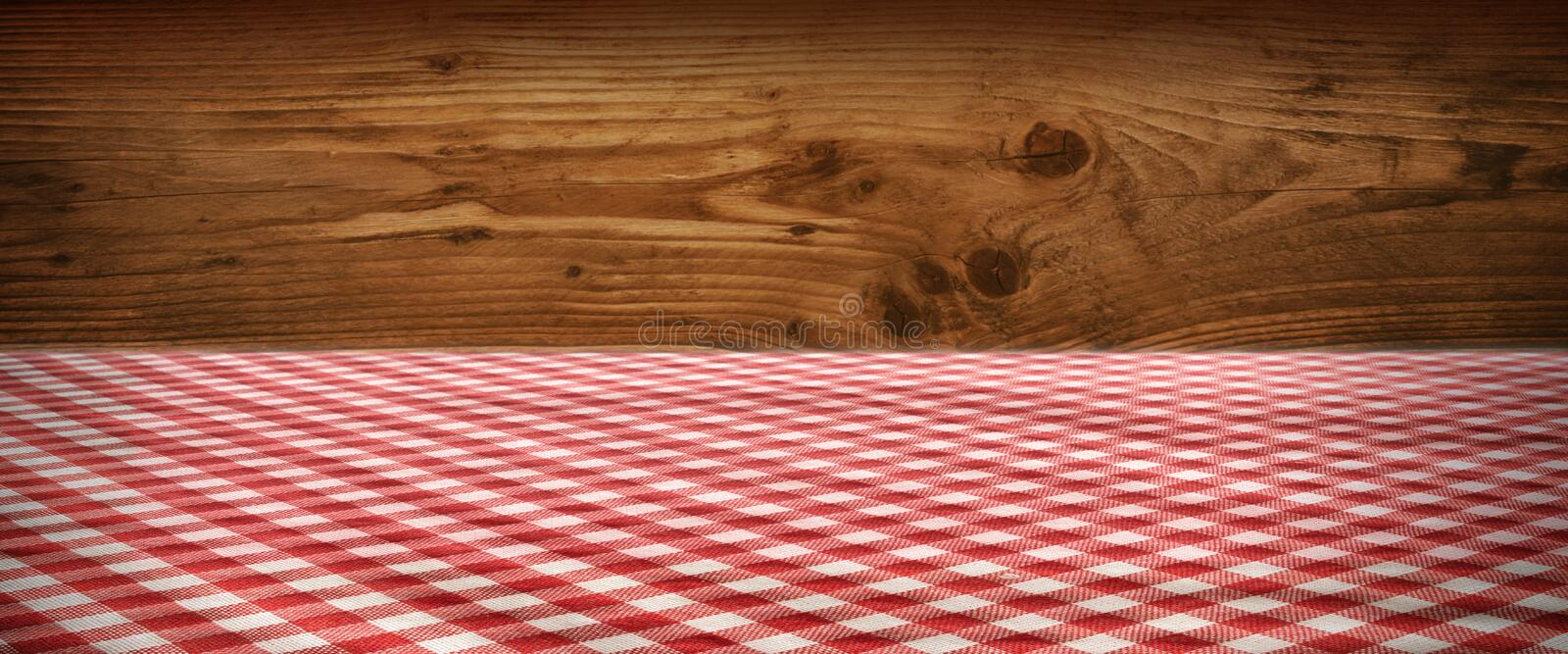Tablecloth checkered in front of wooden wall. Tablecloth red checkered in front of a rustic wooden wall for a bavarian background stock photography