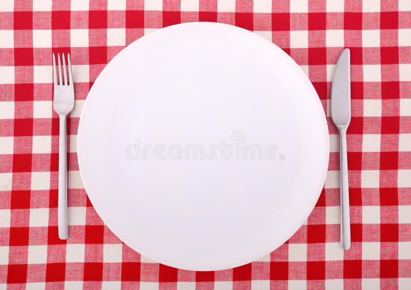 Download Tablecloth With Fork, Knife And An Empty Plate Stock Photos - Image: 13394053