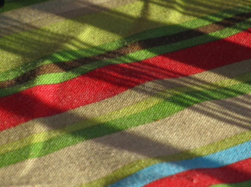 Striped Tablecloth with stripes and shadows royalty free stock image