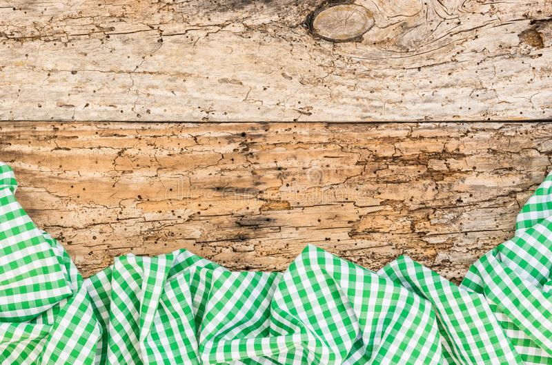 Tablecloth rustic green checked on old wooden table surface. Wooden table background rustic texture, with green checkered tablecloth, high angel view stock photos