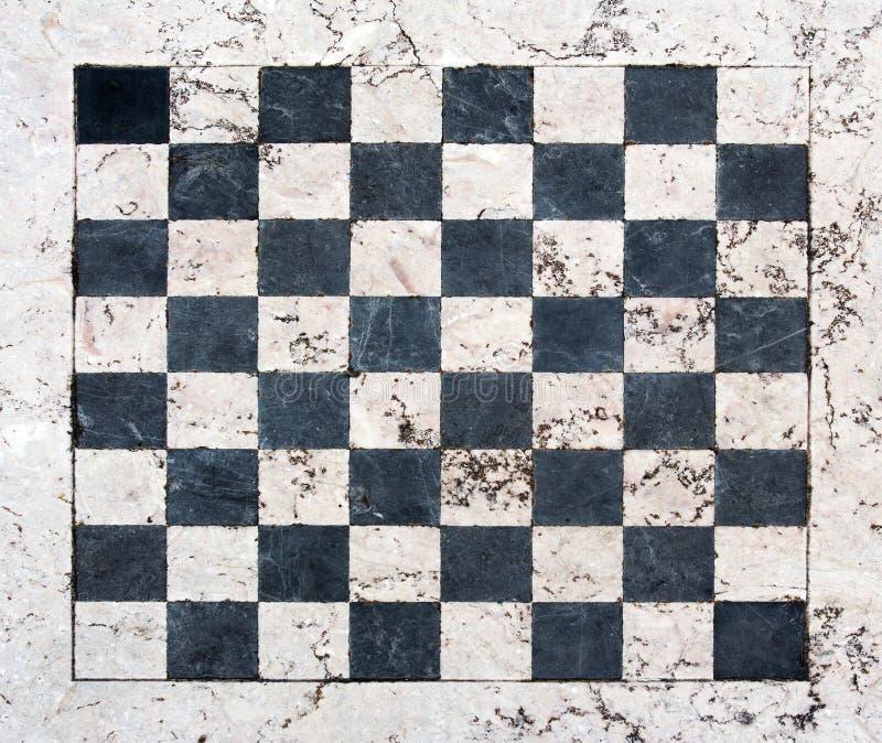Tablero de ajedrez de piedra y de mármol fotos de archivo