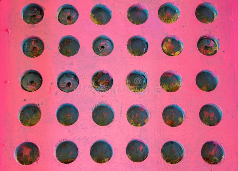 Tablero de clavija de madera rosado brillante foto de archivo libre de regalías