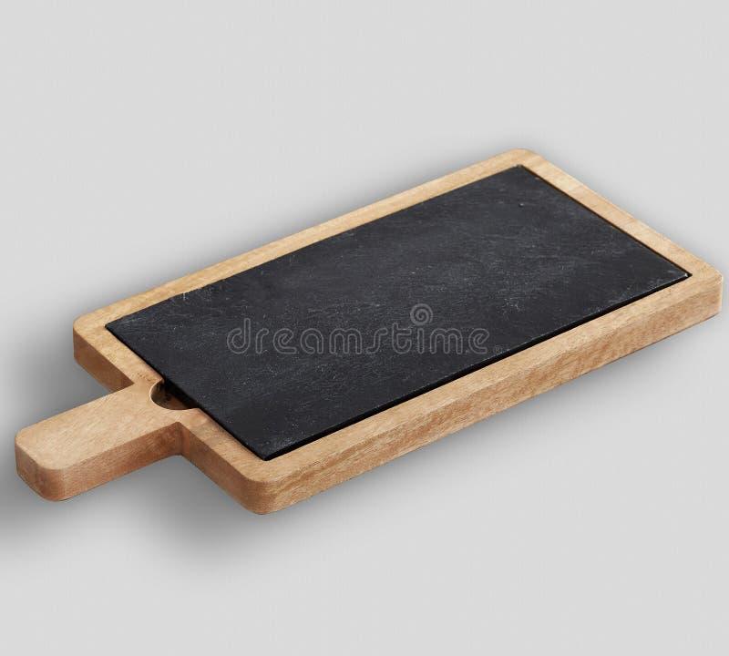 Tablero de madera y del queso de la pizarra con el fondo blanco fotografía de archivo libre de regalías