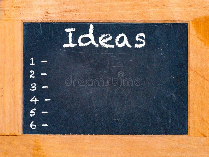 Tablero de tiza de las ideas foto de archivo