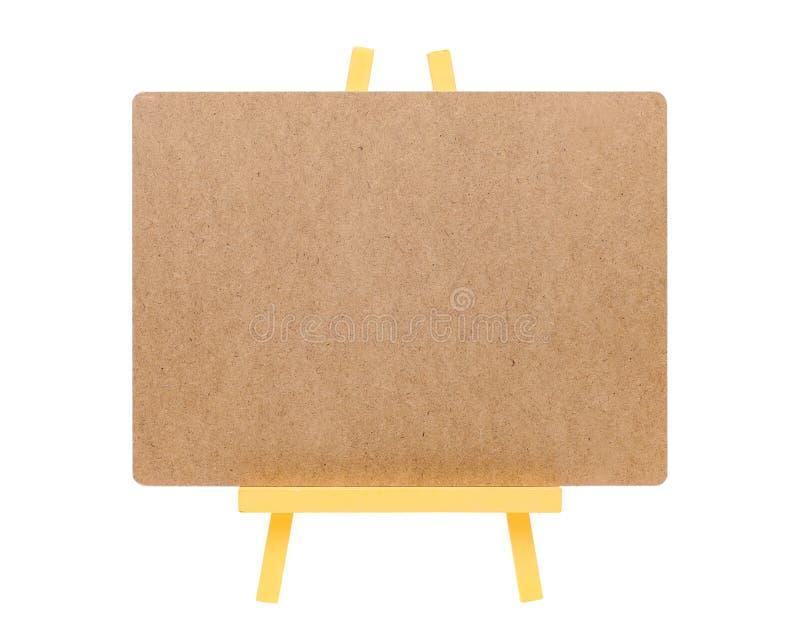 Tablero en blanco y caballete de madera imagenes de archivo
